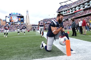 New England Patriots defensive end Rob Ninkovich says a prayer before a game in Foxboro, Mass., on Oct. 26. The Patriots will play in Sunday's Super Bowl.