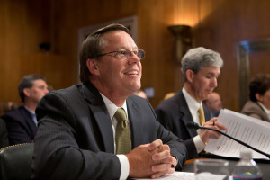 Smithfield Foods CEO Larry Pope prepares to testify before the U.S. Senate Committee on Agriculture, Nutrition and Forestry in July 2013.