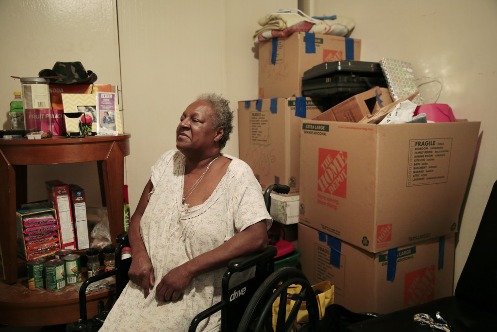 Rhonda Marshall's belongings have been packed in moving boxes for almost a year as she anticipated a voucher allowing her to relocate from the neglected Hacienda public housing complex.