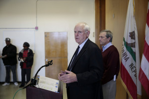 Richmond Mayor Tom Butt speaks during a press conference Friday at the Hacienda public housing complex in Richmond, Calif. Residents will be moved out within six months, officials promised.