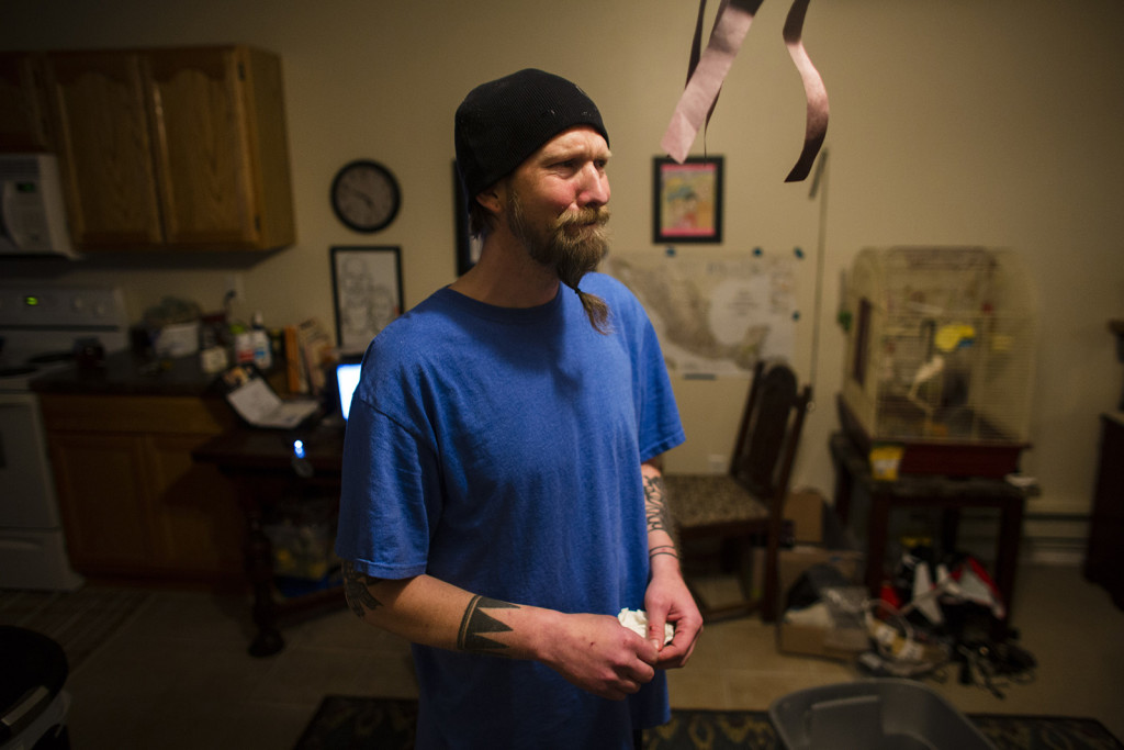 Air Force veteran Jason Bishop, seen during an emotional moment in his La Crosse, Wis., home in January, had a long history of painkiller addiction before seeking treatment at the Tomah VA hospital.