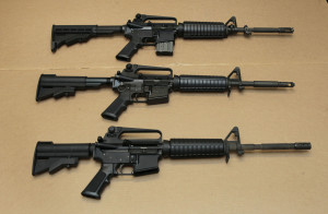 Three variations of the AR-15 assault rifle are displayed at the California Department of Justice in Sacramento, Calif. While the guns look similar, the bottom version is illegal in the state because of its quick reload capabilities.