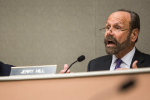"Sen. Jerry Hill said a current law that calls for companies and guards to self-report any firearm discharge or use of force is akin to ""driving down the street, calling the police and telling them I'm going 69 miles per hour in a 65 mile-per-hour zone."""