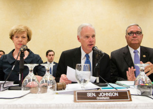 Sen. Ron Johnson (center), Sen. Tammy Baldwin and Rep. Jeff Miller listen to testimony during a congressional field hearing today over overprescription of opiates at the Tomah, Wis., VA hospital.