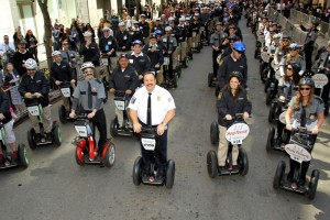 "Kevin James (center), star of ""Paul Blart: Mall Cop 2,"" joins security guards to successfully set two Guinness World Record titles on Segways."