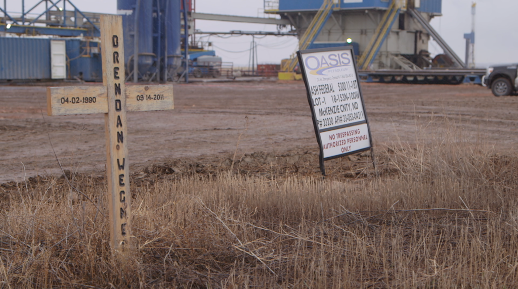 A cross bearing Brendan Wegner's name stands near the site of the oil rig explosion that killed him in 2011. He died on his first day on the rig.