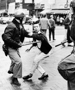 A young Richard Aoki is involved in a 1969 protest at Telegraph Avenue and Bancroft Way near the UC Berkeley campus.