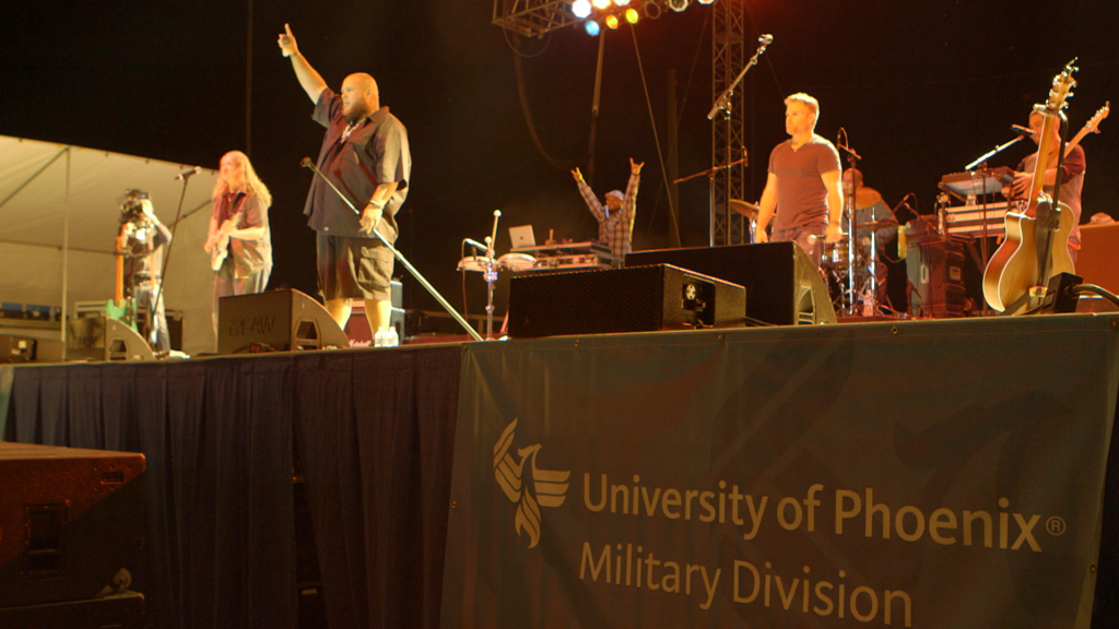 A University of Phoenix banner was on display at the for-profit college's recruitment event at Fort Campbell last year that featured country rapper Big Smo.