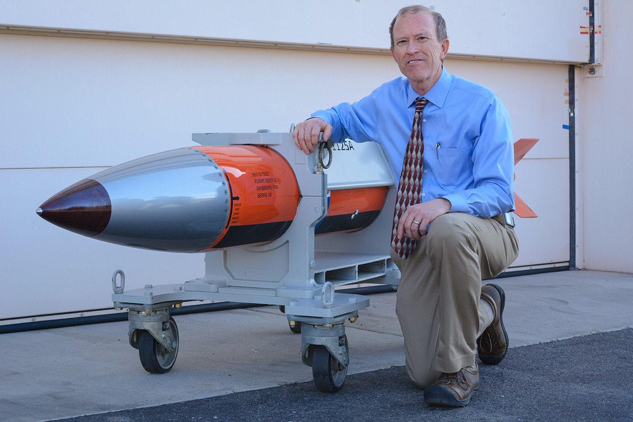 Phil Hoover, an engineer at Sandia National Laboratories, shows off a flight test body for a B61-12 nuclear weapon. Sandia engineers have spent the past few years designing, building and testing the top-secret electronic and mechanical innards of the bomb.