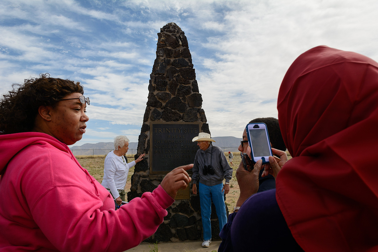 Alison Henry (left) of Farmington, N.M., gives directions to her grandmother as she takes a photo of the obelisk marking the site of first atomic bomb test at Trinity Site at White Sands Missile Range.