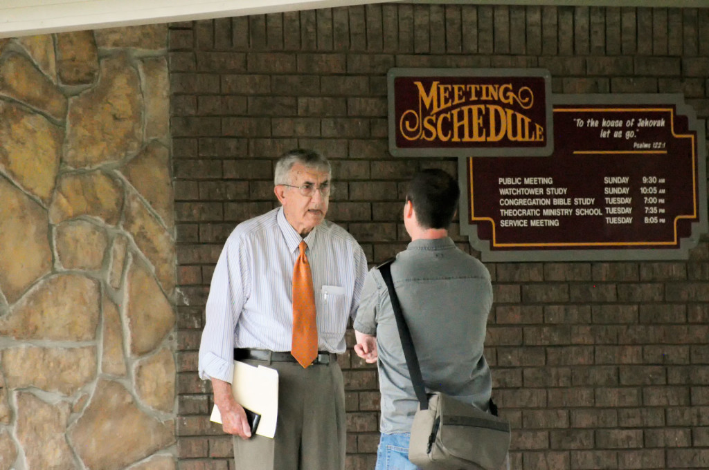 "Reveal reporter Trey Bundy (right) talks to Debbie McDaniel's father, Wendell Marley, who is an elder in McAlester's congregation of Jehovah's Witnesses. He said he wanted nothing to do with McDaniel and her ""immoral lifestyle."""
