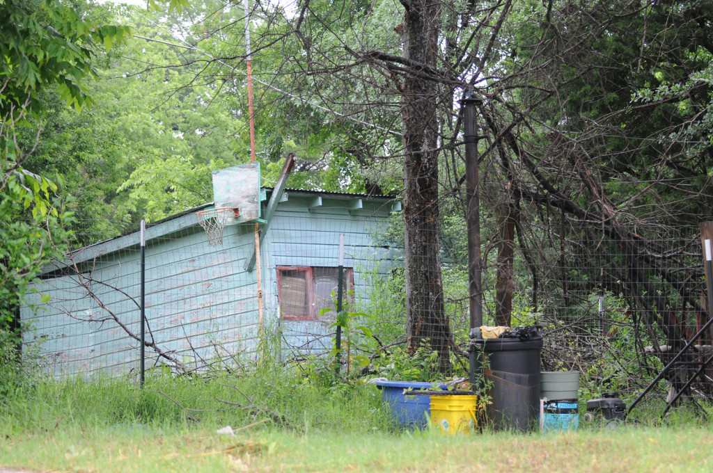 An aboveground pool once stood near this shack in the backyard of elder Ronald Lawrence's former home. In the 1970s and '80s, Lawrence hosted pool parties here for local Witness children.