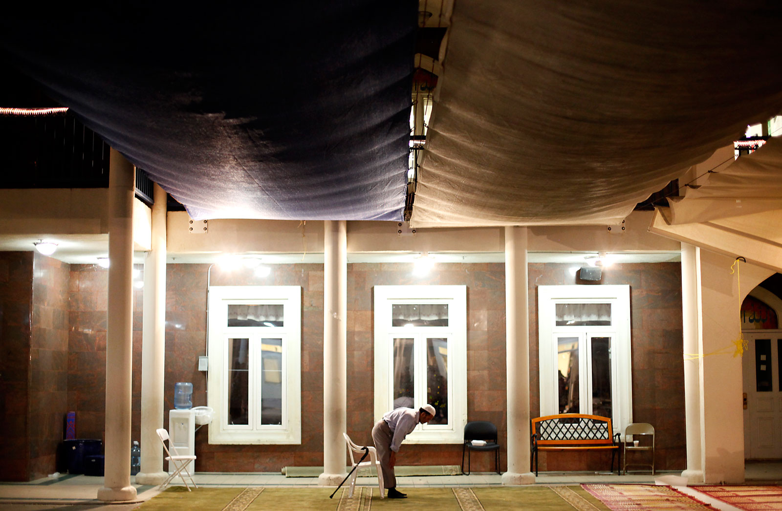 A man prays at Islamic Society of East Bay. Many of the mosque's congregants know little about its board's internal quarrels or the money being spent on court battles.