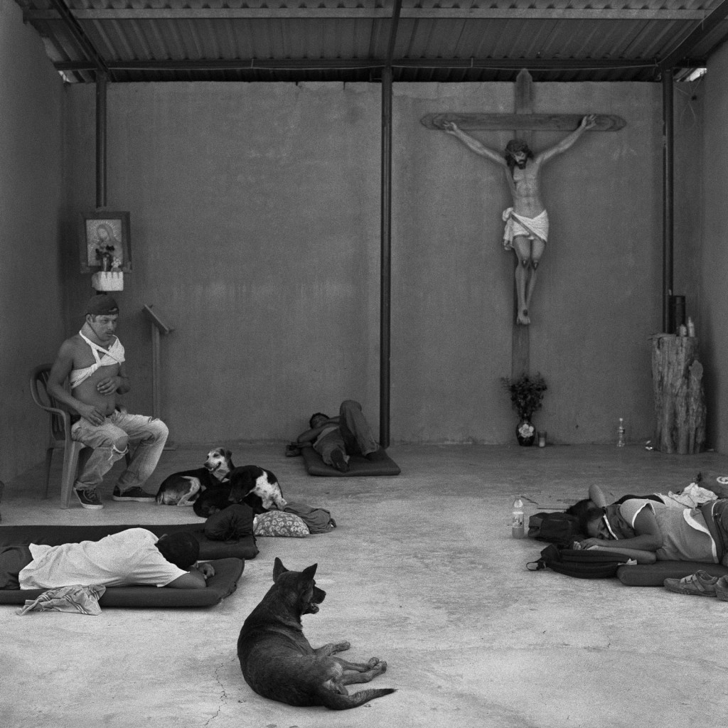 "Support along the way ranges from women who toss homemade food onto the trains to shelters run by Catholic priests. Weary and injured migrants rest up in a makeshift chapel at the Hermanos en el Camino immigrant shelter, in the small town of Ixtepac, Oaxaca. A fence outside the center makes its intentions clear, in man-size letters: ""Bienvenidos Migrantes,"" Welcome Migrants. On the first night it was opened, in 2007, more than 400 sought refuge."