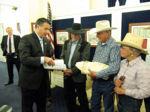 Nevada Gov. Brian Sandoval (from left) accepts petitions from Assemblyman Ira Hansen and Battle Mountain ranchers Peter and Lynn Tomera in May 2014. The Tomeras have received funds from a federal drought disaster relief program.
