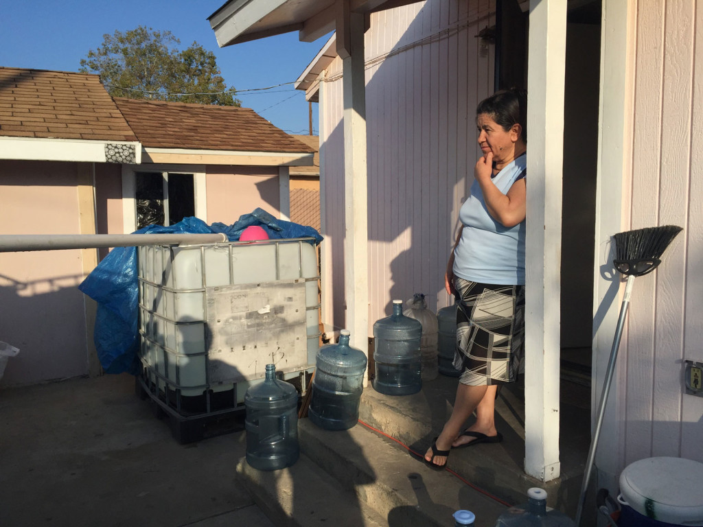 A local nonprofit donated and installed a 265-gallon tank at Socorro Ambriz's house in East Porterville, Calif. Every week, Ambriz's brother fills three 55-gallon barrels at a nearby water station; he makes two trips so her family of four can shower, flush their toilets and wash dishes.