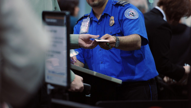 A Transportation Security Administration agent verifies a passenger's identification and boarding pass at LaGuardia Airport in New York. In 2015, agents failed to find hidden weapons more than 95 percent of the time during 70 tests carried out by undercover auditors.