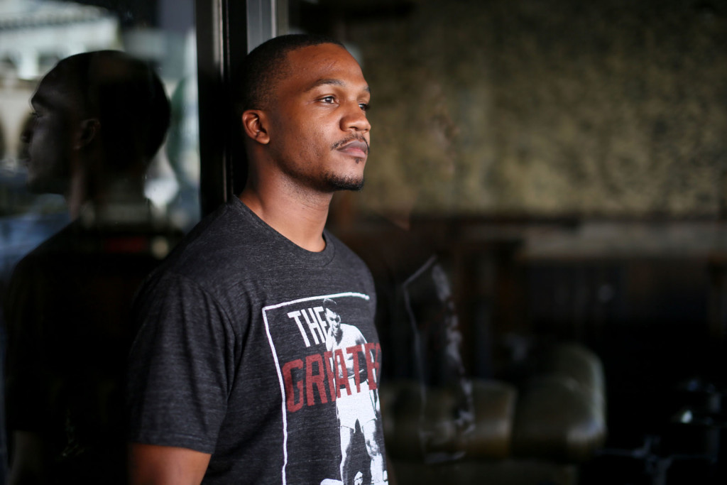 "Aaron Harvey, who spoke at an Assembly committee hearing today in favor of opening up California's gang database to more public scrutiny, said he was ""a real-life example of the destruction that documentation can cause in a person's life,"" highlighting his arrest and the eight months he spent in jail while awaiting trial."