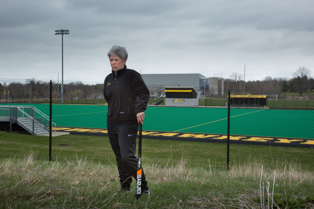 Former field hockey head coach Tracey Griesbaum, seen at the University of Iowa's Grant Field, won four Big Ten titles in 14 years. She says she was fired in retaliation for speaking out about the school's lack of gender equity in women's sports.