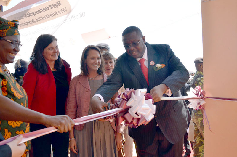 In 2012, Malwaian Vice President Khumbo Kachali (right) cuts a ribbon during the opening ceremony for a DAPP teachers training college in Malawi. Standing alongside him are longtime Teachers Group member Marie Lichtenberg (second from left) and Kate Snipes (third from left) of the USDA office in Kenya. CREDIT: USDA/Flickr
