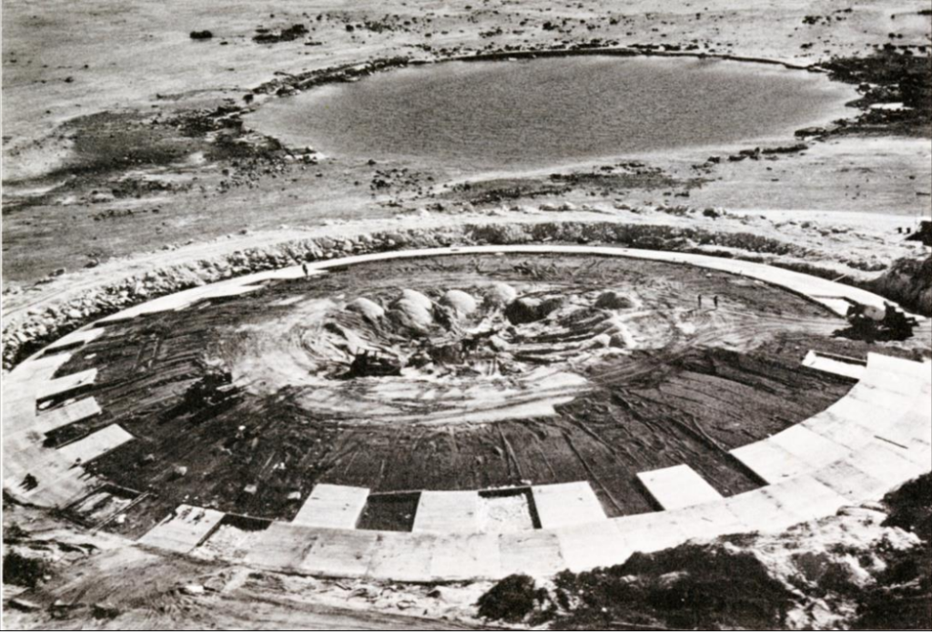 View of the Cactus crater containment structure during construction of individually formed concrete panels.