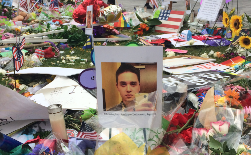 The memorial at the Dr. Philips Performing Arts Center, centering on a laminated photo of Christopher Andrew Leinonen; He was an immigrant from Chile, killed along with his boyfriend, Juan Guerrero.