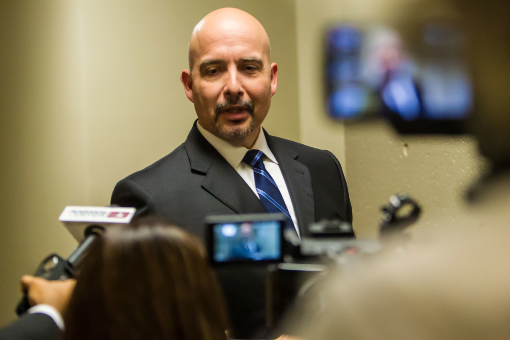 "Attorney Carlos A. Garcia speaks to the media after an arraignment hearing for his client, Joel Luna, who has pleaded not guilty to murder and drug trafficking charges. ""We believe this is a clear case of 'you've got the wrong guy,' "" Garcia said."