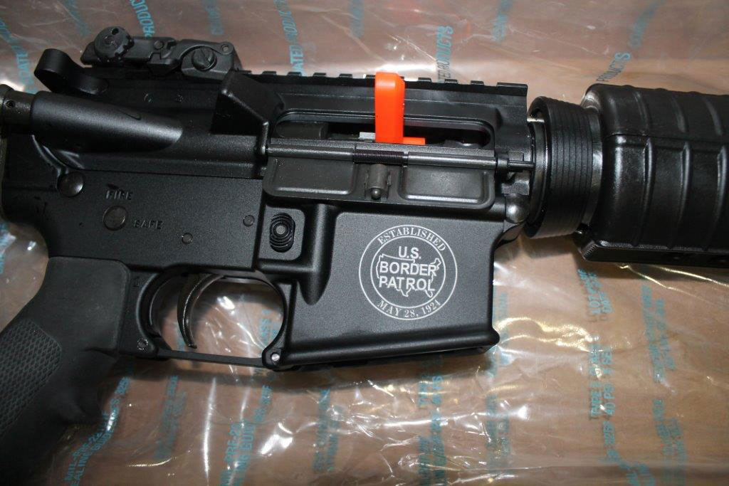 This AR-15 rifle, stamped with the U.S. Border Patrol logo, was recovered from Joel Luna's house.