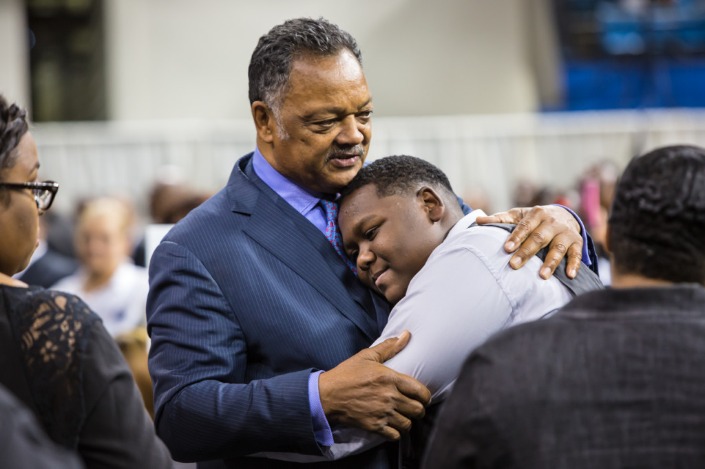 "Rev. Jesse Jackson gives Cameron Sterling, Alton Sterling's son a hug at Alton Sterling's funeral. The funeral was held at Southern University's F.G. Clark Activity Center in Baton Rouge. Over a thousand people attended religious leaders including Rev. Jesse Jackosn, Al Sharpton politicians, family members and friends friends.The Rev. Jesse Jackson told those at Alton Sterling's funeral ""Stop the violence, save the children. Stop the violence, save the nation.""""For those of you who are listening here and around the world, our strongest weapons are not guns and violence, it's the righteousness of our cause"" and that,""Unearned suffering is redemptive. There is power in innocent blood. If the killing of Alton Sterling would have been in a shootout or a drug bust or robbery, we would not be here today."""