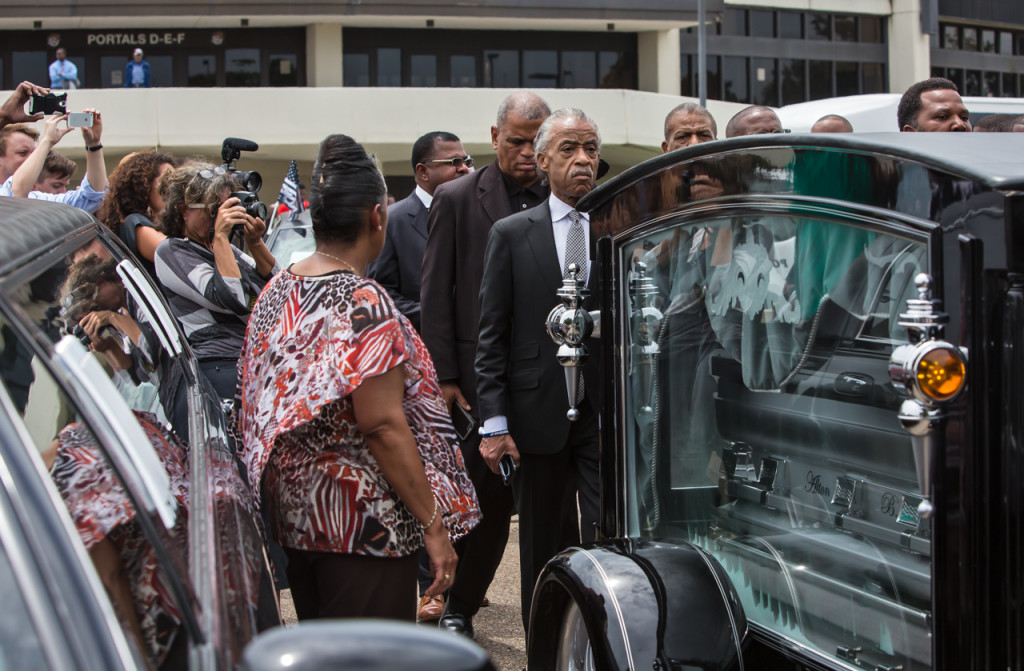 Rev. Al Sharpon leading a procession behind the casket of Alton Sterling in glass covered hearse following his funeral in Southern University's F.G. Clark Activity Center in Baton Rouge. Over a thousand people attended the public funeral where religious leaders including Rev. Jesse Jackosn, Al Sharpton politicians, family members and friends friend's spoke.