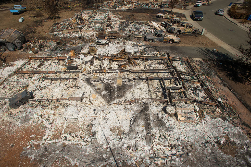 Destroyed homes and vehicles scorched by the Valley fire line Jefferson St. in Middletown, Calif, on Monday, Sept. 21, 2015. According to fire officials, the blaze ranks as the sixth worst wildfire in California history after destroying more than 1,000 structures, burning more than 75,000 acres and leaving at least three people dead.