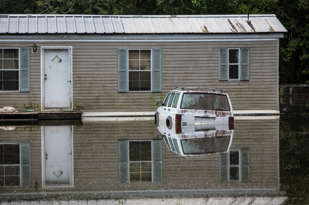 A vehicle remains stuck in flooded Ascension Parish, Louisiana, on Aug. 27.
