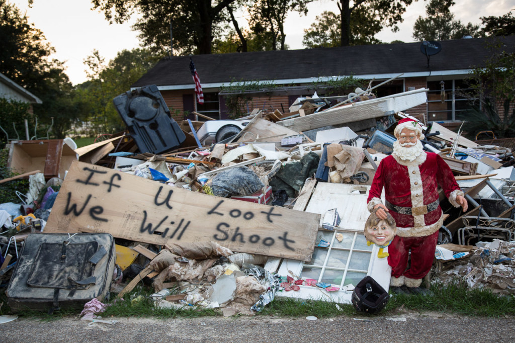 "Piles of belongings line the streets in Denham Springs, Louisiana, on Sept. 1 as homeowners hold on to hope that they'll be able to rebuild. A dancing Santa is getting ""his last dance,"" said homeowner Lisa Herbert."