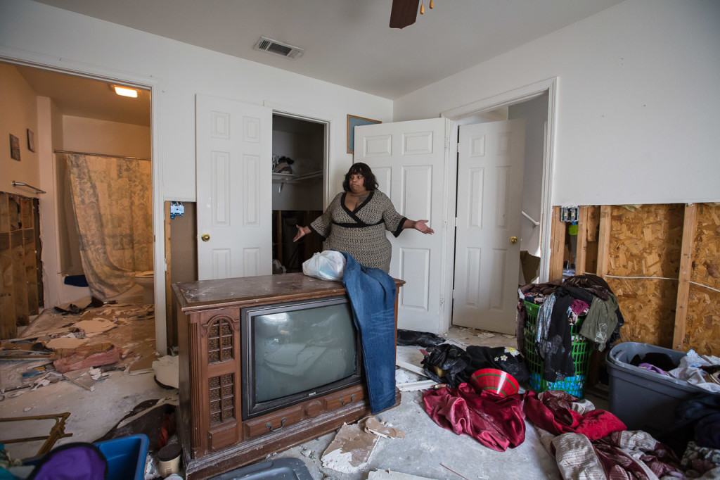 Carletta Cannon surveys the extensive damage to her home and belongings on Sept. 3 in the Townhomes of Sherwood Forest complex in Baton Rouge. Cannon has been displaced by the flood and said all of her clothes were destroyed.