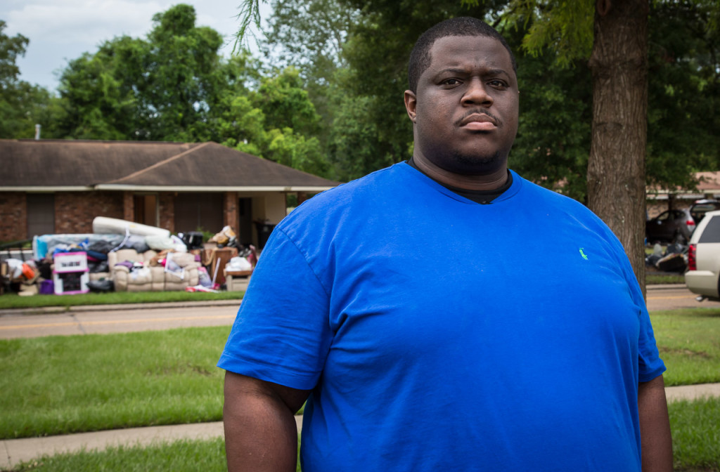 Community activist Gary Chambers, who has led a call for justice in the Baton Rouge community following the police shooting death of Alton Sterling, visits the mostly black neighborhood of Glen Oaks, where most homes were flooded.