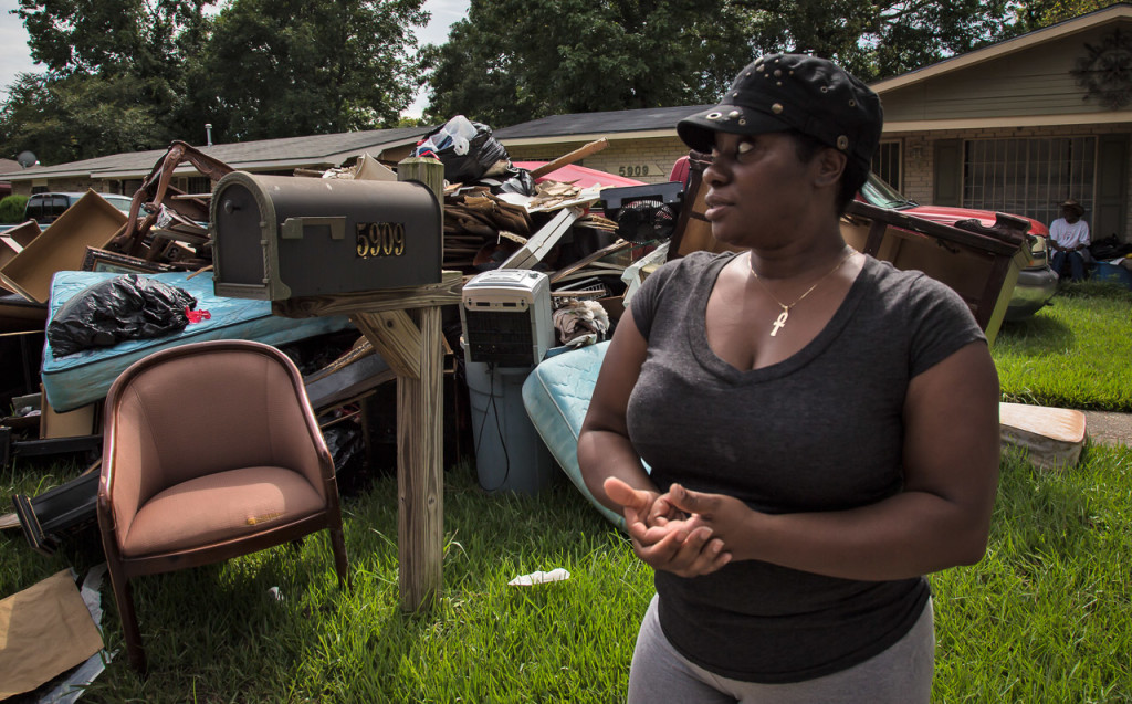 Roxanna Johnson, of East Fairlane, a Baton Rouge subdivision, discusses on Aug. 19 being rescued by boat during the storm.