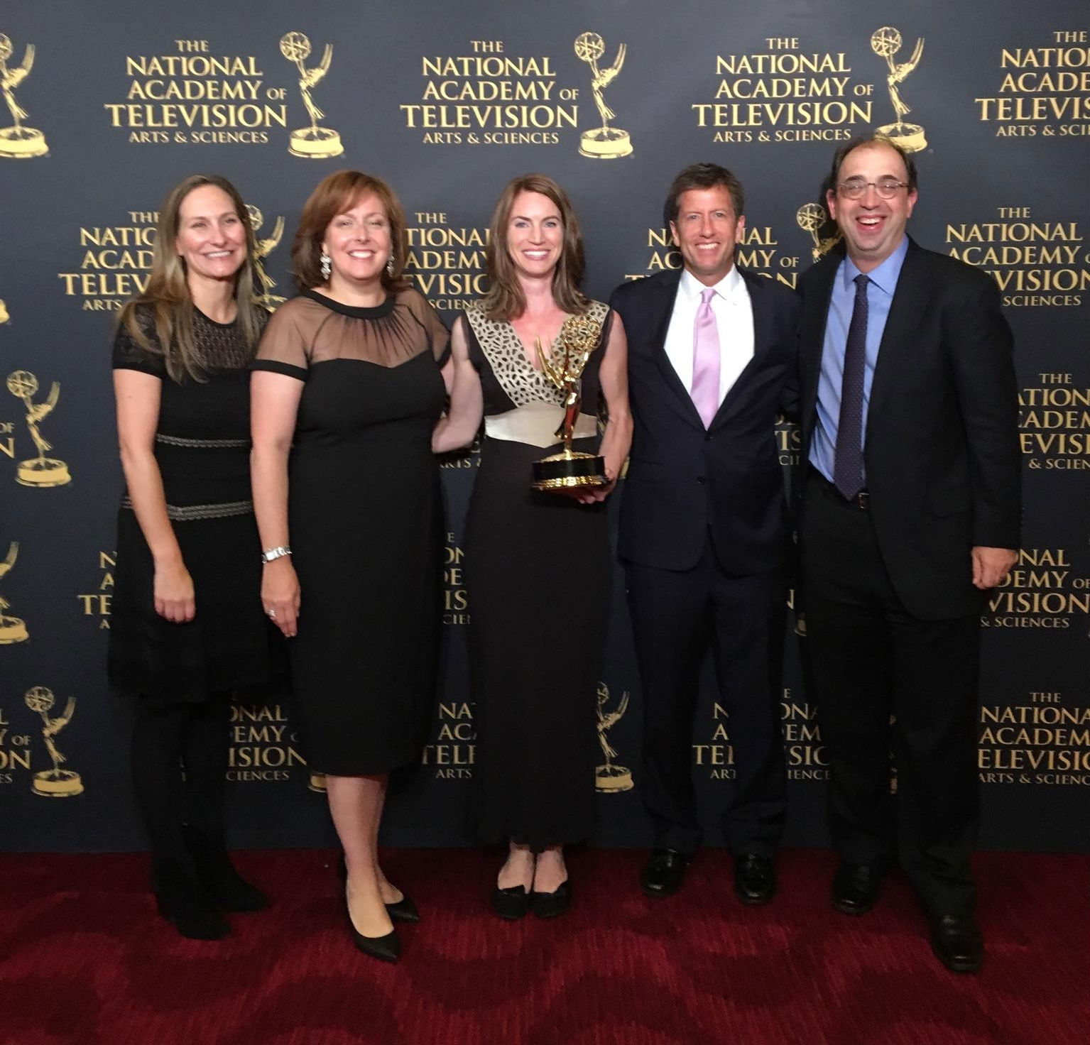 "Amanda Pike, Reveal's Director of Video and Executive Producer, Sara Just, Executive Producer of the PBS NewsHour, Reveal reporter Jennifer Gollan, Richard Coolidge, Senior Producer of the PBS NewsHour, and Murrey Jacobson, National Affairs Editor at the PBS NewsHour pose at the News & Documentary Emmy Awards in New York City Sept., 21, 2016 after receiving the Emmy for outstanding business and economic reporting in a regularly scheduled newscast for ""Deadly Oil Fields."""