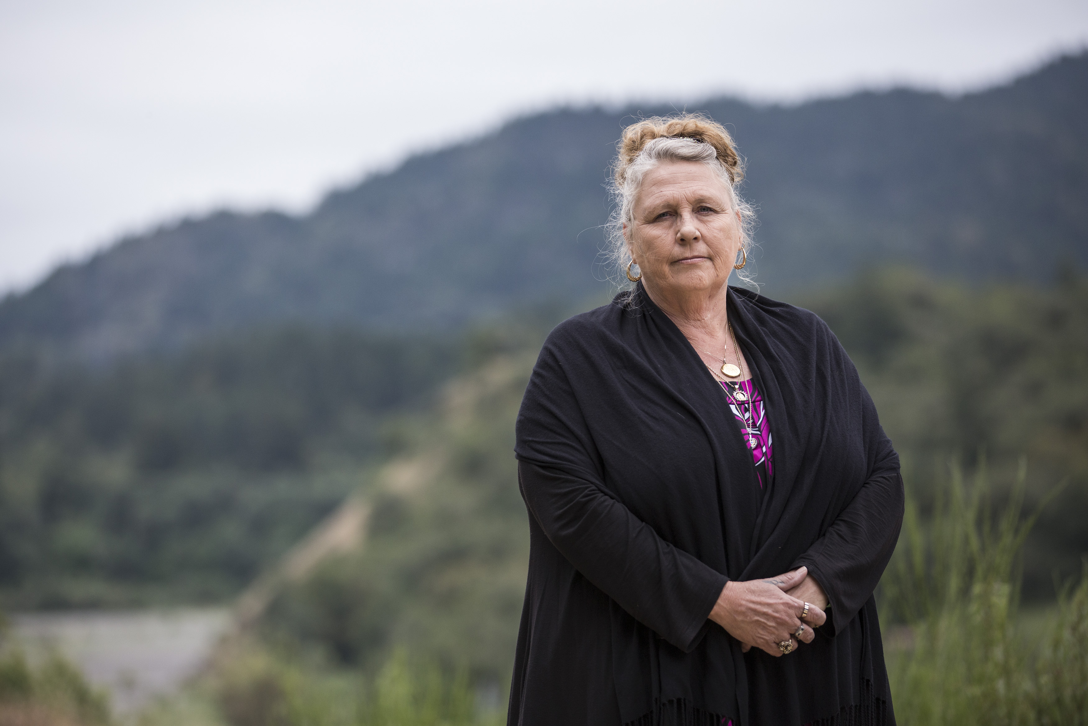 "Debra Carey, a human rights activist and volunteer who helps immigrants, the homeless and seasonal workers in need, poses for a portrait near a homeless encampment she helped secure for those in need nicknamed ""Hippie Hill,"" in her home town, Garberville, CA, on May 13, 2016."