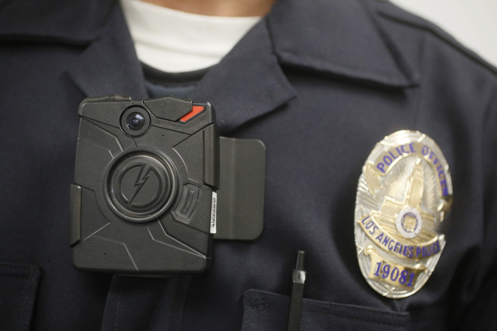 A Los Angeles police officer wears a body camera during a demonstration in January 2014. The Obama administration gave more than $41 million in the past two years to help law enforcement agencies across the country buy body cameras for officers.