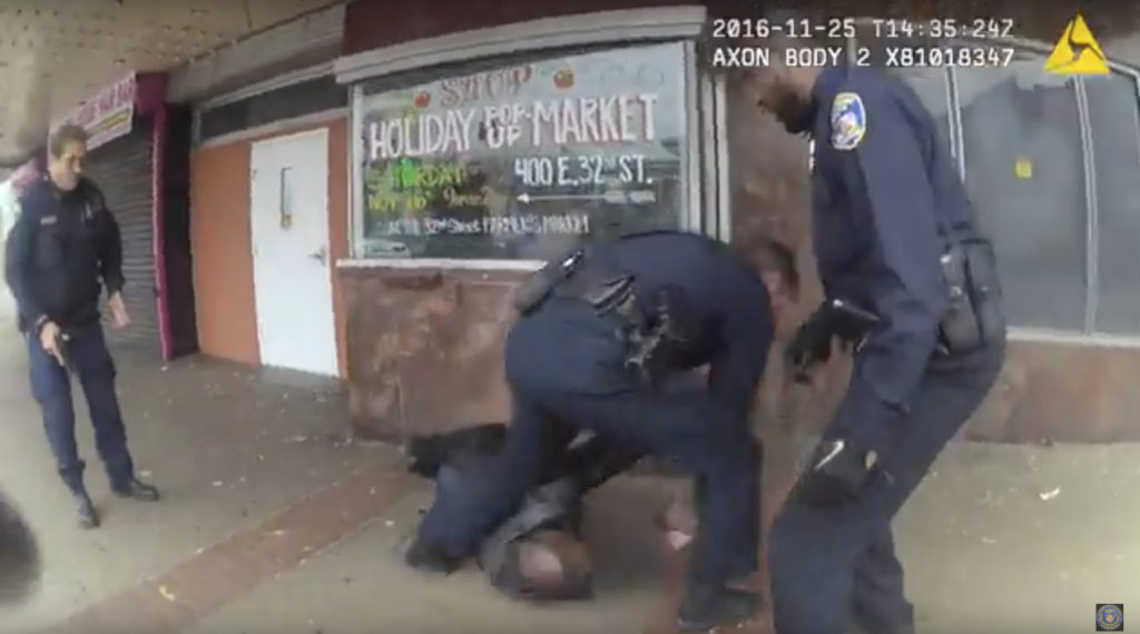 A body camera worn by a Baltimore officer captures cops tending to a man who was shot by police on Nov. 25. Baltimore police released the footage on Nov. 30. The man was expected to survive.