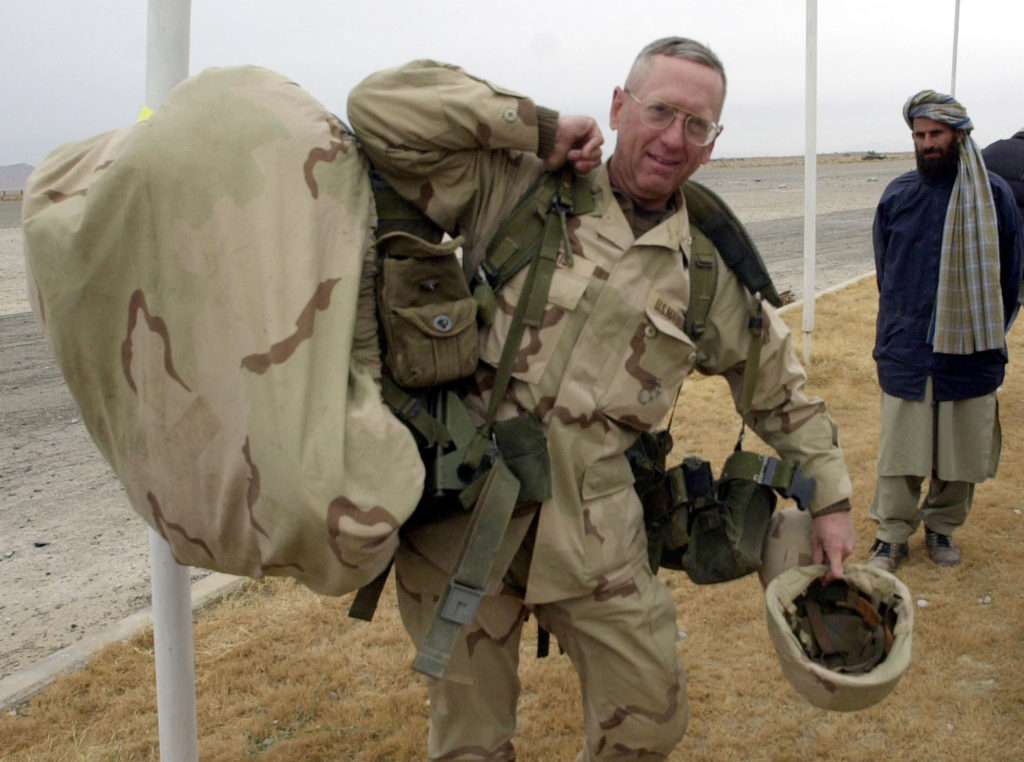 Then-Brig. Gen. James Mattis carries his packs in Kandahar, Afghanistan, in December 2001. Mattis had climbed up the ranks and became a four-star general during the Iraq War.