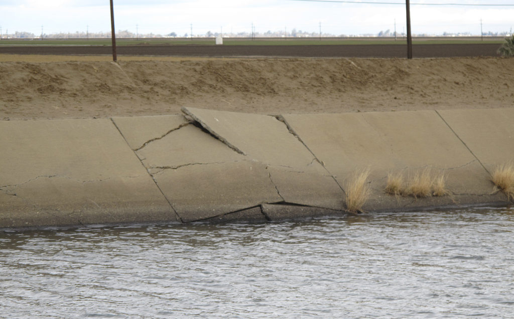 The lining of the Delta-Mendota Canal near Dos Palos, Calif., is buckling because of sinking land. Californians are using too much water, causing the sinking of prime agricultural area in the Central Valley.
