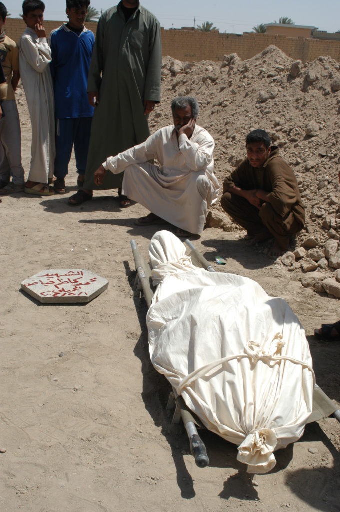 Many of the bodies left to rot in the streets of Fallujah were taken to the municipal soccer stadium to be buried after Marines withdrew from the city.