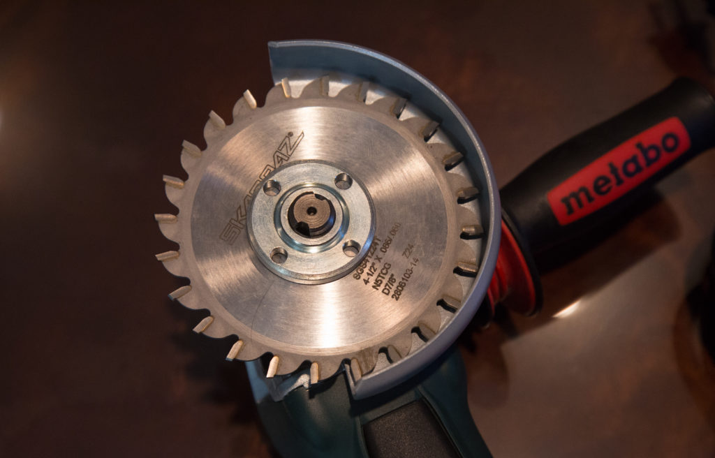 "Officials at Austal modified this Metabo grinder by attaching a saw blade with teeth. Metabo Corp. explicitly warns against attaching this kind of blade because it can ""create frequent kickback and loss of control."""