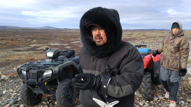 Eric Atagotaaluk and his son Kailapi Smiler arrive by ATV at the proposed site of the Innavik hydro project, a 10 km drive inland from the coastal village of Inukjuak.