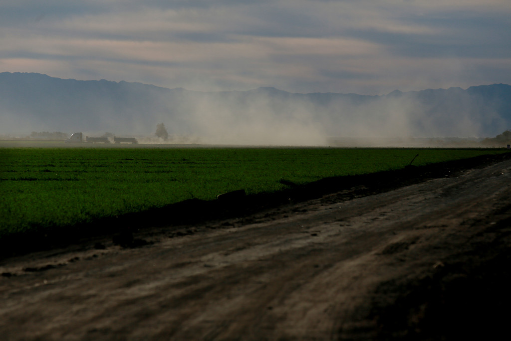 Dust from offroad vehicles swirls outside El Centro, Calif. For decades, sparsely populated Imperial County has violated federal and state clean air standards.