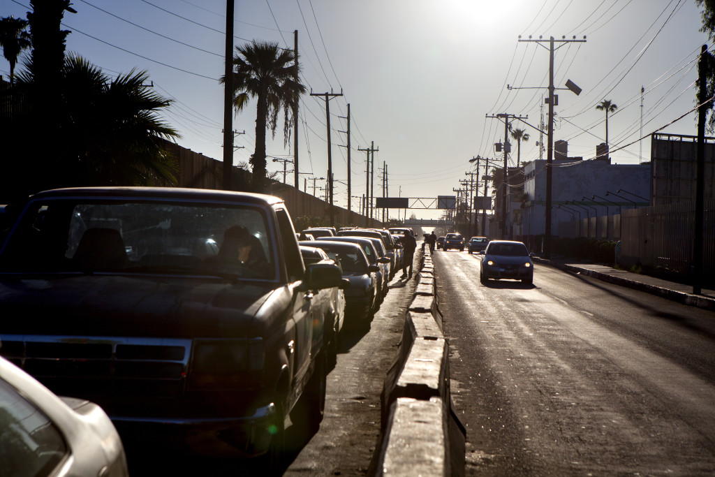 Cars wait to cross into the United States from Mexicali, Mexico. Northbound commuters typically wait between 45 minutes and two hours to cross.