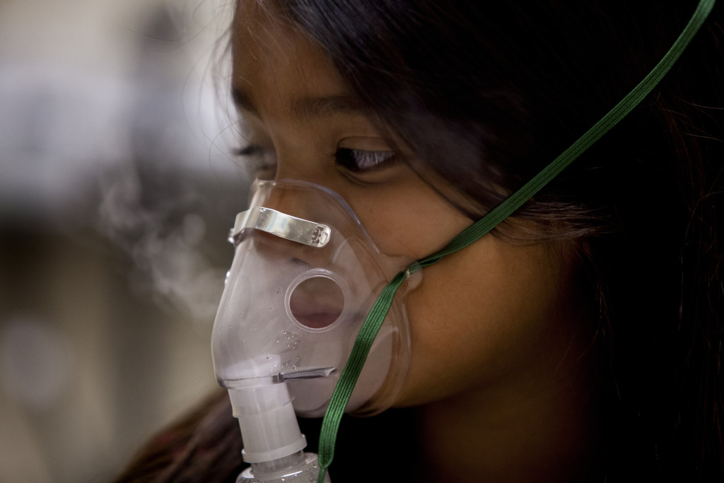 Delarie Juarez, 7, who has asthma, is hooked up to a nebulizer because she was wheezing. In California's Imperial County, children are rushed to emergency rooms for asthma at a rate that's nearly double the state average.