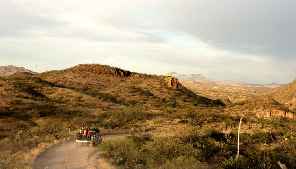 A truckload of people head from Sasabe, Mexico, to a dropoff spot near the border, where they will attempt to cross illegally on foot into the U.S. through Arizona in this May 2006 photo.