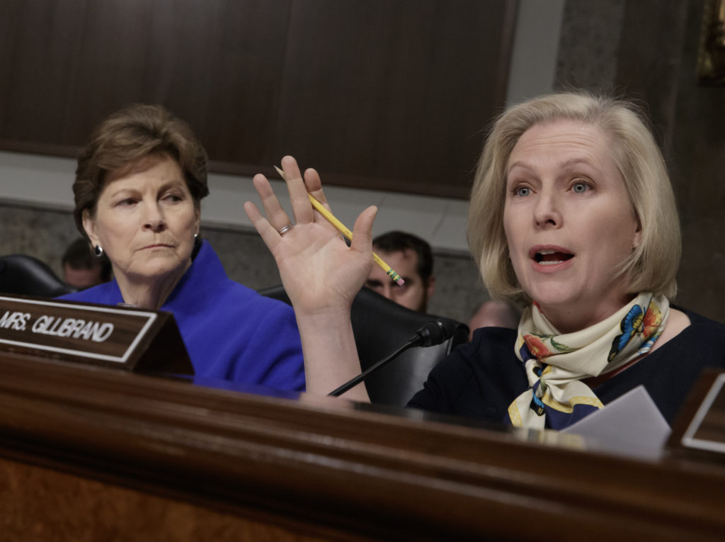"Sen. Kirsten Gillibrand, D-N.Y., joined at left by Sen. Jeanne Shaheen, D-N.H., questions Marine Gen. Robert B. Neller, the commandant of the Marine Corps, at a Senate Armed Services Committee hearing on the investigation of nude photographs of female Marines and other women that were shared on the Facebook page ""Marines United,"" on Capitol Hill in Washington, Tuesday, March, 14, 2017."